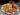 Friterade Lollipops - kycklingben med mangosalsa och guacamole
